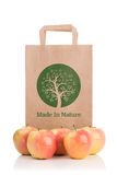 Paper bag with apples Royalty Free Stock Images