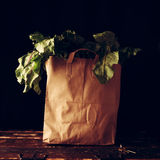 Paper bag with beet greens. Concept of healthy grocery shopping Royalty Free Stock Photo