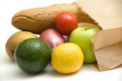 Paper bag with bread, fruits and vegetables Stock Photos