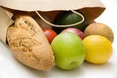 Paper bag with bread, fruits and vegetables Royalty Free Stock Images
