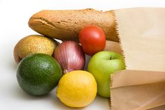 Paper bag with bread, fruits and vegetables Royalty Free Stock Photos