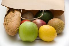Paper bag with bread, fruits and vegetables Royalty Free Stock Photo
