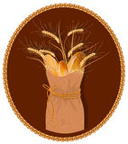 Paper bag with bread and wheat. Royalty Free Stock Images