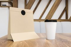 Breakfast in paper bag and coffee to go on table stock illustration
