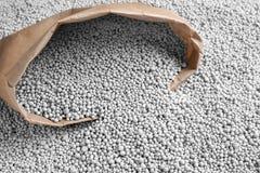 Paper bag and chemical fertilizer. Gardening season stock photos