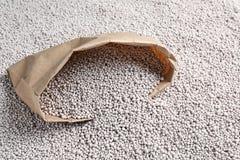 Paper bag and chemical fertilizer. Gardening season royalty free stock photos