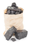 Paper bag with coal Royalty Free Stock Images