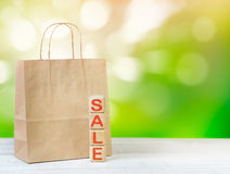 Paper bag cubes word sale empty space background. Royalty Free Stock Photography