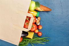 Paper bag with different of vegetables and fruits Stock Image