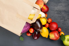 Paper bag with different of vegetables and fruits Royalty Free Stock Photography