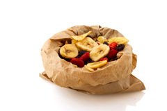 Paper bag with dried fruit Royalty Free Stock Images