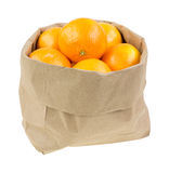 Paper bag filled with small oranges Royalty Free Stock Image