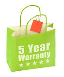Paper bag with five year warranty inscription. On white background Royalty Free Stock Photos