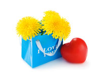 Paper bag with flowers and heart Royalty Free Stock Photography