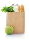 Paper bag with food. Brown paper bag with food isolated on a white background stock image