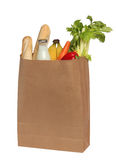 Paper bag with food over white Royalty Free Stock Photography