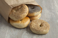 Paper bag with fresh bagels Royalty Free Stock Photo