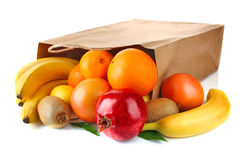 Paper bag with fresh ripe fruit Royalty Free Stock Photo