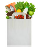 Paper bag full of groceries. Isolated on white Royalty Free Stock Photography