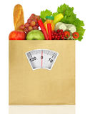 Paper bag full. Of groceries with weighing scale Stock Photo