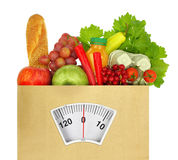 Paper bag full. Of groceries with weighing scale Royalty Free Stock Images