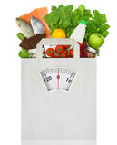 Paper bag full of groceries. With weighing scale Stock Photos