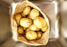 A paper bag full of potatoes royalty free stock images