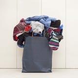 Paper bag full of socks Royalty Free Stock Photography