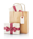 Paper bag with gift Stock Images