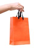 Paper bag on a hand Royalty Free Stock Images