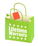 Paper bag with lifetime warranty inscription Royalty Free Stock Photos