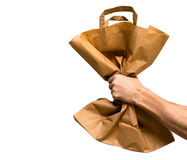 Paper bag in male hand isolated from white Stock Images