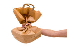 Paper bag in man's hand Stock Photos