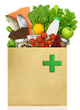 Paper bag with medical green cross Stock Photos