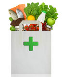 Paper bag with medical green cross Royalty Free Stock Photo