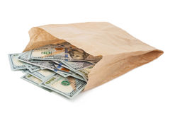 Paper bag with money. On white background royalty free stock image