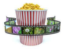 Paper bag with popcorn and movie reel Stock Images