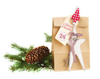 Paper bag with present for 24 december Royalty Free Stock Images