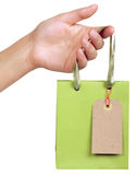 Paper bag with a price tag Royalty Free Stock Photography