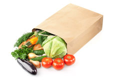 Paper bag with products Royalty Free Stock Photos
