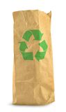 Paper bag and recycle symbol. Brown paper bag with recycle symbol against white background, gentle minimal shadow in front and left side Royalty Free Stock Photo