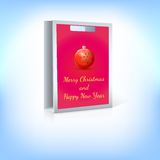 Paper bag, red Christmas ball with greeting Royalty Free Stock Photos