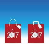 Paper bag red with happy new year 2017 and ball on it illustrati. On in colorful Royalty Free Stock Photography