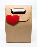 Paper bag with red heart over wrapping paper on white background Stock Photography