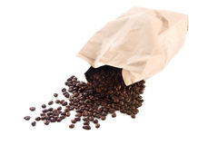 Paper bag with roasted coffee beans. On a white background Stock Images