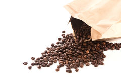 Paper bag with roasted coffee beans. On a white background Stock Photography