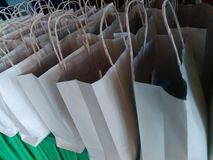 Paper bag. Row of bag on table Royalty Free Stock Photos