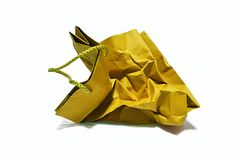 Paper bag. A paper bag or paper sack is a preformed container made of paper, usually with an opening at one end. It can be one layer of paper or multiple layers Stock Photo