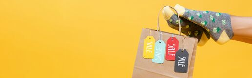 Paper bag with sale tags hanging