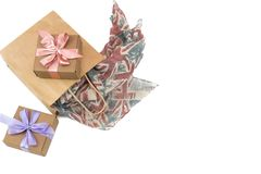 Paper bag for shopping chiffon scarf and two gift boxes on white background. Top view flat lay Stock Image
